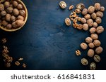 whole nuts on the wooden black... | Shutterstock . vector #616841831