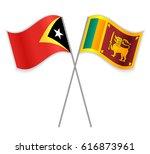 timorese and sri lankan crossed ... | Shutterstock .eps vector #616873961