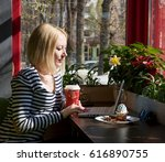 girl in the coffee shop around... | Shutterstock . vector #616890755