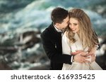 beautiful young couple in love... | Shutterstock . vector #616935425