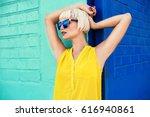 beautiful young woman walking... | Shutterstock . vector #616940861