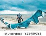 Kitesurfer Pumping Fills With...