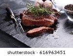 barbecue rib eye steak on slate ... | Shutterstock . vector #616963451