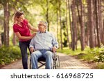 smiling woman with her disabled ... | Shutterstock . vector #616968725