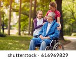 woman visiting her disabled... | Shutterstock . vector #616969829