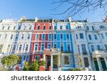 london   march 30  a row of... | Shutterstock . vector #616977371