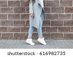 Woman In White Sneakers And...