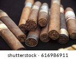 Cigars on black background