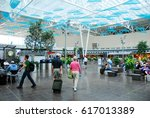 Small photo of Indianapolis, IN, USA May 31, 2010 Travelers scurry through the atrium of the Indianapolis International Airport
