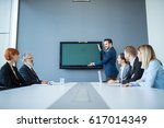 handsome businessman presenting ... | Shutterstock . vector #617014349
