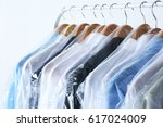 rack of clean clothes hanging... | Shutterstock . vector #617024009