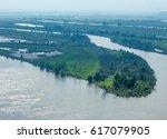 summer river. high rock. blue... | Shutterstock . vector #617079905