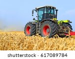 modern tractor on field works | Shutterstock . vector #617089784