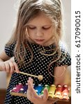 cute blond child playing with... | Shutterstock . vector #617090015