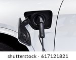 electric vehicle charging... | Shutterstock . vector #617121821
