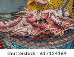 grilled squid is a favorite of... | Shutterstock . vector #617124164