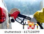 petrol gun with car | Shutterstock . vector #617126099