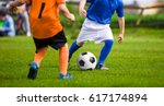 two little kids playing... | Shutterstock . vector #617174894