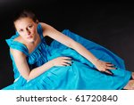 young pretty girl in long blue...   Shutterstock . vector #61720840