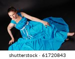 young pretty girl in long blue... | Shutterstock . vector #61720843