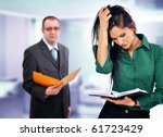 Business situation, manager  having doubts about young female employees skills - stock photo