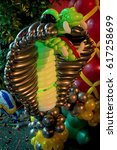 colorful big cobra balloon... | Shutterstock . vector #617258699