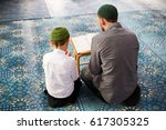 the father teaches the child to ... | Shutterstock . vector #617305325