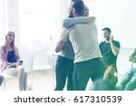 people hug cheer up rehab... | Shutterstock . vector #617310539
