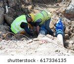 construction workers install... | Shutterstock . vector #617336135