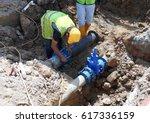 construction workers install... | Shutterstock . vector #617336159