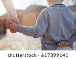 mother and son walking holding...   Shutterstock . vector #617399141