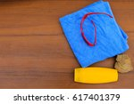 beach accessories on wooden... | Shutterstock . vector #617401379