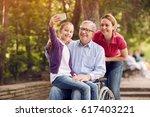 granddaughter using phone for... | Shutterstock . vector #617403221