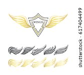 hand drawn stippling wings' set.... | Shutterstock .eps vector #617404499