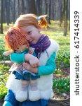 happy little redhead girl holds ...   Shutterstock . vector #617414339