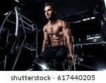 bodybuilder in the gym doing... | Shutterstock . vector #617440205