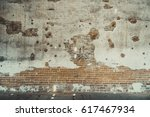 painted cracked wall texture.... | Shutterstock . vector #617467934