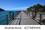 walkway over the river in navia ... | Shutterstock . vector #617489444