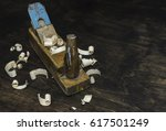 old wooden plane and wood... | Shutterstock . vector #617501249
