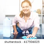young woman washing her table... | Shutterstock . vector #617506025
