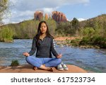 young women doing yoga in the... | Shutterstock . vector #617523734