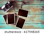 retro camera and empty old... | Shutterstock . vector #617548265