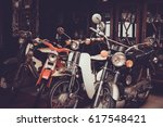 old and classic motorcycle... | Shutterstock . vector #617548421