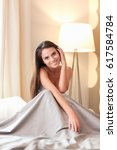 beautiful brunette lying on bed ...   Shutterstock . vector #617584784