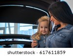 small girl and mom in...   Shutterstock . vector #617611859
