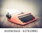 retro old orange typewriter... | Shutterstock . vector #617613881