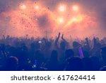 dancing party crowd people... | Shutterstock . vector #617624414