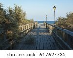 wooden pathway that goes to the ... | Shutterstock . vector #617627735