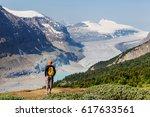 hiking man in canadian... | Shutterstock . vector #617633561