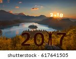young woman standing on summit... | Shutterstock . vector #617641505